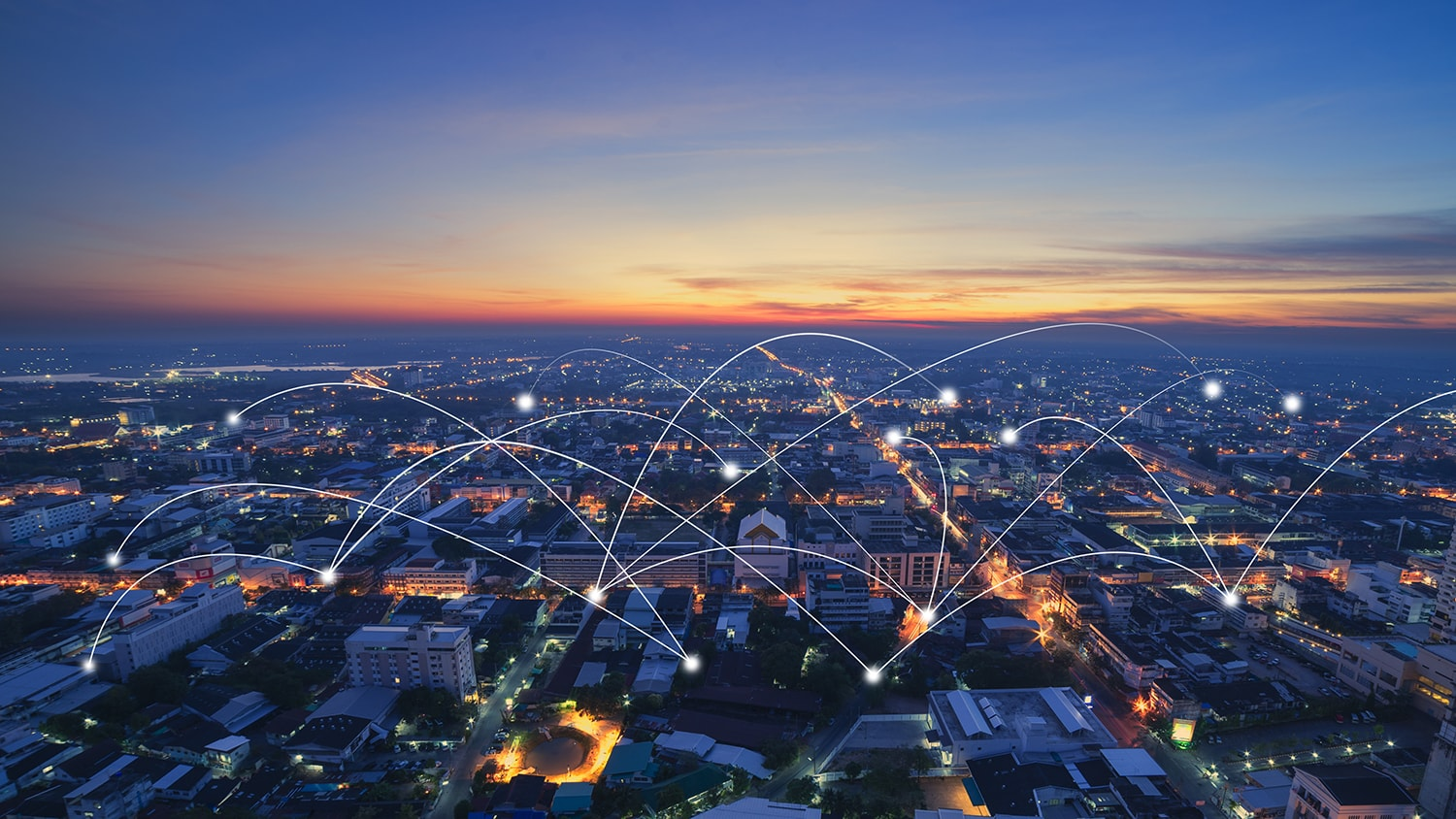 City at night with network connectivity lines