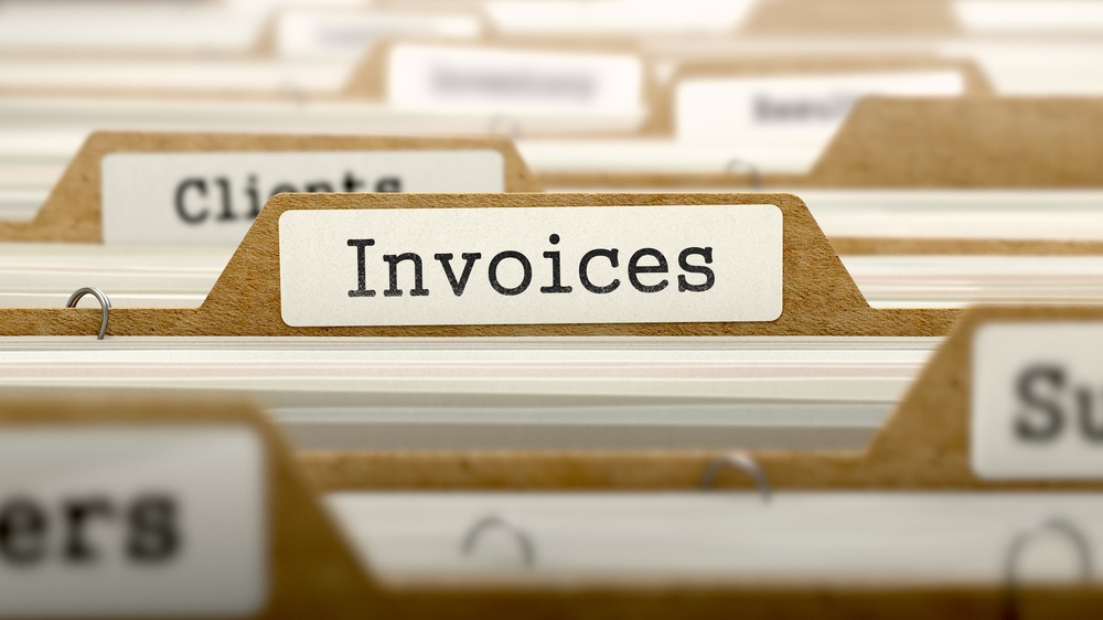 Invoices Concept. Word on Folder Register of Card Index. Selective Focus.